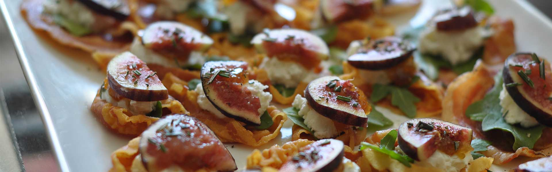 Catered appetizer with fig panchetta crips