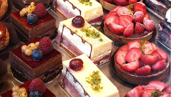 tray of delicious french bakery desserts and cakes