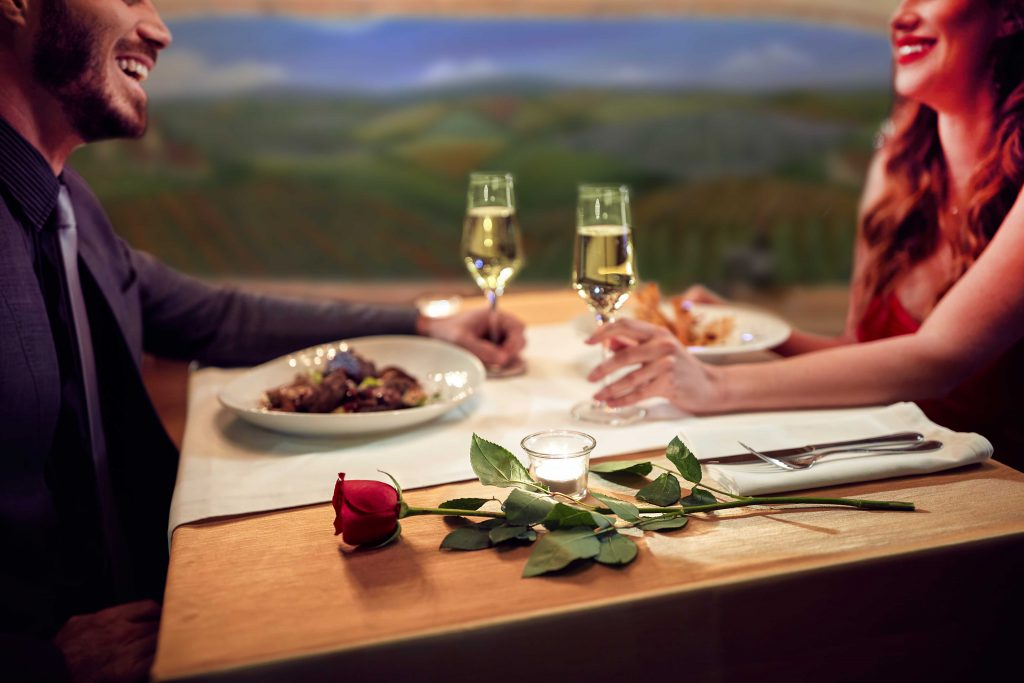 romantic setting of the French Gourmet - restaurant in San Diego with couple seated at table enjoying dinner conversation