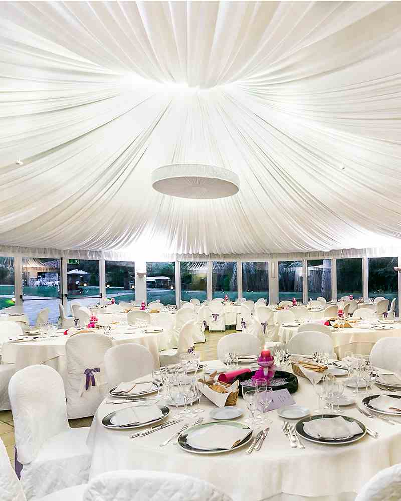 elegant wedding venue with table layouts for sit-down dinner